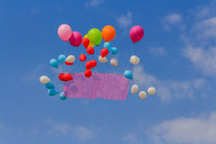Flying balloons banner in blue sky background. Flying balloon banner in blue sky background stock photos