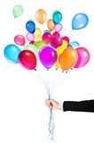 Flying balloons with Businessman hand Stock Image