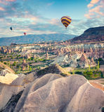 Flying on the balloons early morning in Cappadocia. Colorful spring scene in Red Rose valley, Goreme village location, Turkey, Asia. Artistic style post Royalty Free Stock Images