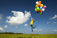 Flying with balloons Royalty Free Stock Photo