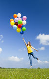 Flying with balloons Stock Photography