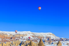 Flying balloons over mountains. Capadocia. Turkey. Flying balloons over mountains of Capadocia at sunset. Turkey Royalty Free Stock Images