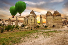 Flying balloons in rock landscape, Cappadocia, Turkey Royalty Free Stock Image