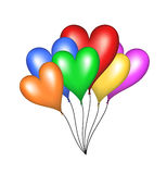 Flying balloons in shape of heart Stock Image