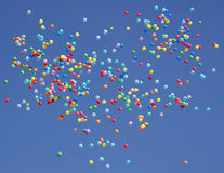 Flying balls created the outline of a heart. Colorful balloons flying in the sky Stock Photo
