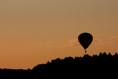 Flying baloon at sunset Stock Photography