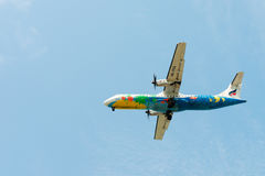 Flying Bangkok Airlines airplane in clean blue sky Royalty Free Stock Image