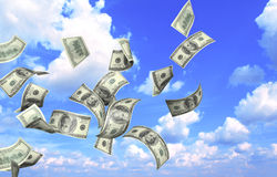 Flying banknotes of dollars Stock Photos
