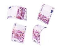 Flying 500 banknotes of euros. Isolated on white Stock Photos
