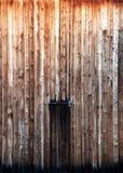 Flying of a barred wooden door Stock Image