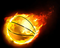 Flying basketball on fire. Falling from the dark Stock Photos