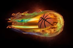 Flying basketball on fire. On black Stock Photos