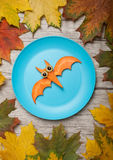 Flying bat made of carrot on plate royalty free stock photography