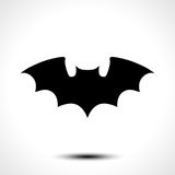 Flying bat silhouette. Vector illustration Stock Images
