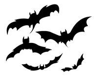 Flying bats. Black silhouettes of bats for Halloween flying on white background Stock Photography