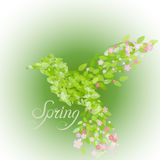 Flying beautiful bird with flowers and green leaves Royalty Free Stock Images