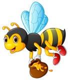 Flying Bee cartoon holding honey bucket Stock Photos