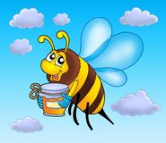 Flying bee holding honey Royalty Free Stock Photos