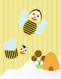Flying bee and honeycomb Royalty Free Stock Photos