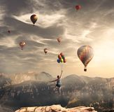 Flying with big balloons royalty free stock photo