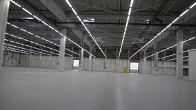Flying through the big empty warehouse stock footage