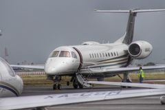 Flying big. This Legacy jet visiting the airport and getting ready to be airborne soon stock photos