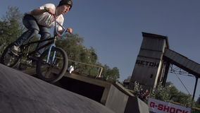 Flying on a Bike. Competition among professionals and fans of extreme sports. Young men perform stunts on bikes. Slow Motion at a rate of 240 fps stock footage