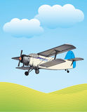 Flying biplane Stock Image