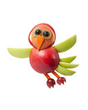 Flying bird made of apple royalty free stock image