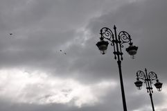 Flying Birds with Classic Lampposts Stock Photo