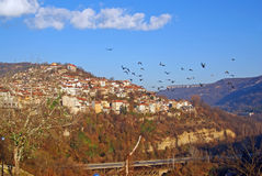 Flying birds over veliko tarnovo Royalty Free Stock Image