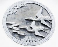 Flying birds stone carving Royalty Free Stock Images