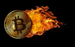 Flying Bitcoin Engulfed in Flames. A bitcoin flying and engulfed in trailing flames with sparks flying on a black background. Concept of a hot crypto currency Royalty Free Stock Images