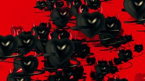 Flying black devils hearts with horns and tail on red stock video footage