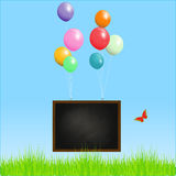 Flying blackboard with balloons Royalty Free Stock Images