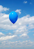 Flying blue ball. In the sky Stock Photography