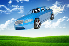 Flying blue car. On nature background with green field Royalty Free Stock Photography