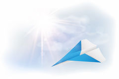 Flying blue paper plane, sky, clouds and sun Royalty Free Stock Images