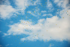 Flying blue and yellow baloons Royalty Free Stock Photography