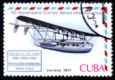 Flying boat and international airmail service 1st flight cachet. MOSCOW, RUSSIA - FEBRUARY 12, 2017: A stamp printed in Cuba shows Flying boat and international Royalty Free Stock Photo