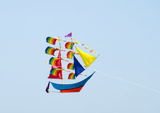 Flying Boat Shaped Kite. A Boat shaped kite flying with just Sky as background Royalty Free Stock Photo