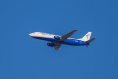 Flying Boeing 737 - 405 aircraft, Blue Air Flight Royalty Free Stock Images