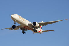 Flying a Boeing 777-31HER (A6-EGN ) Emirates Airline on blue sky background Royalty Free Stock Photo