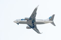 Flying Boeing 737-524 of Utair company Royalty Free Stock Images