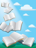 Flying books. Open flying books in the sky with sunshine Stock Photos