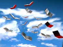 Flying books. Open flying books on the blue sky - rendered 3d model Royalty Free Stock Images