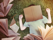 Free Flying Books Around Sleeping Boy In Grass Stock Photo - 37025250