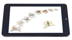 Flying books on display of tablet pc isolated Stock Photography