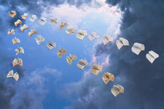Flying books in evening sky Stock Photography