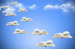 Flying books on sky stock image